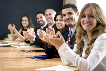 Business group clapping